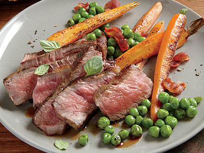 herb-rubbed-new-york-strip-sauteed-peas-carrots.jpg