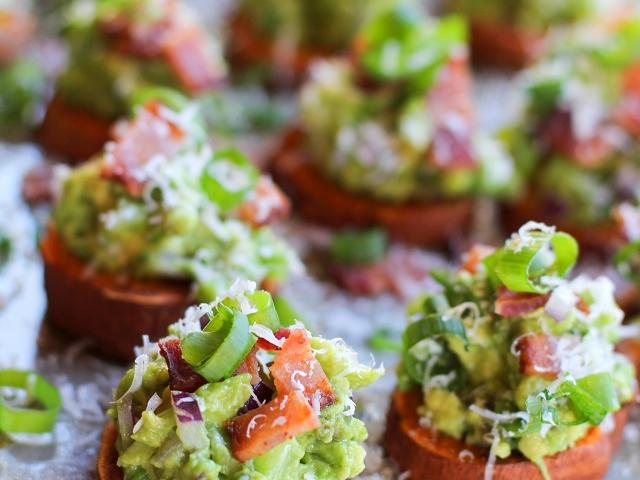 roasted_sweet_potato_rounds_with_guacamole_and_bacon_hero.jpg