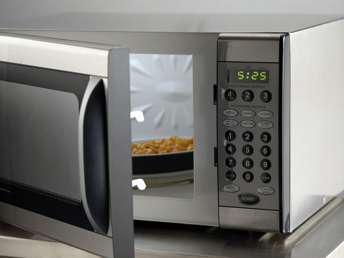 Microwave with food inside and door open