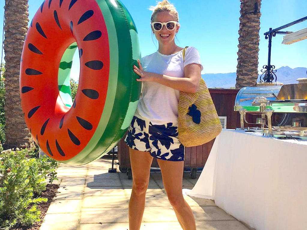 """Coachella poolside fun!"" Reese Witherspoon captioned an Instagram photo of herself carrying a fruity float. BUY IT: $19.99; macys.com"