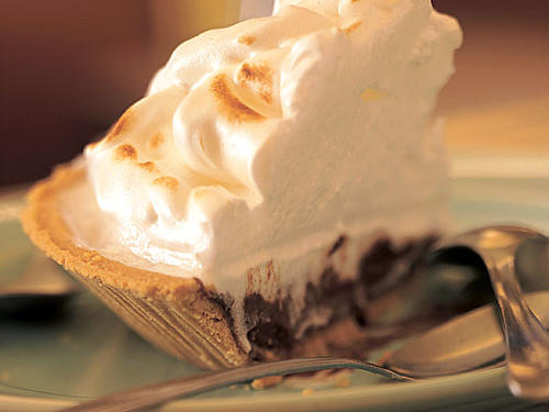 Fat-free milk thickened with cornstarch for the filling and meringue instead of whipped cream on top makes this a lighter, just as tasty choice than a traditional chocolate pie.