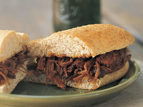 Beef brisket is tender and flavorful when prepared in a pressure cooker. Whip up the zesty barbecue sauce, and you have the makings for hearty sandwiches to serve at your next gathering.