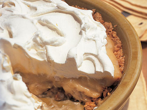 Bananas that are firm rather than extra-ripe work best in this pie. Fluffy whipped topping is perfect atop a filling of peanut butter and banana goodness.