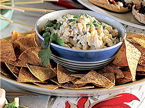 "The Stir Crazy Supper Club may be based in Indianapolis, but living far from the coast hardly dampens their love for good seafood. Here's their menu of coastal-inspired recipes that can be made anywhere, starting with this all-time favorite crab dip.""An instant hit! No one believes this is a ""light"" recipe, but it is,"" says Nancy. ""Serve with crackers, chips, or crudites, and expect to take home a sparkling clean bowl.""""I always make a double batch of this, it is very simple yet delicious,"" says Michelle. ""At a birthday party a few years ago, I found a friend eating the remains of the dip with a spoon, straight from the bowl. It's that good!"""