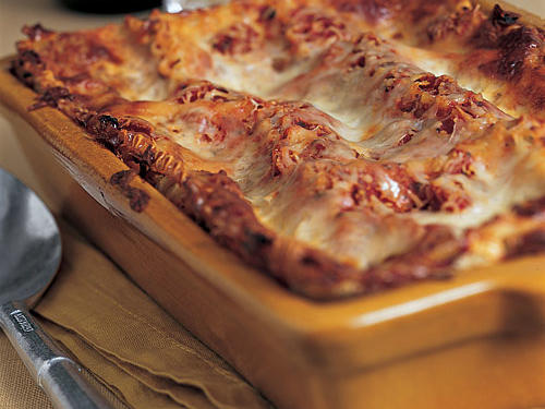 """This lasagna weighs in at under 300 calories a serving and doesn't skimp on flavor. AtHomeGourmetPC found it perfect for make-ahead meals. """"A great freezer recipe! I am a personal chef and this is a great make-ahead dish. The cheese filling tastes so rich."""""""