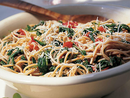 As they mature in the summer's heat, arugula leaves get hot and spicy as well as plentiful and cheap. Even when cooked, they have an assertive personality, a good match for the whole-wheat spaghetti.