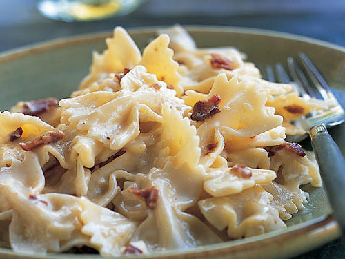 It's common to associate carbonara with spaghetti, but this dish uses fun farfalle-shaped pasta for a small twist on a delicious Italian classic.