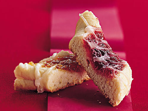 Think of these as a variation of thumbprint cookies. Vanilla butter cookies are filled with fruit preserves and drizzled with a powdered sugar glaze.