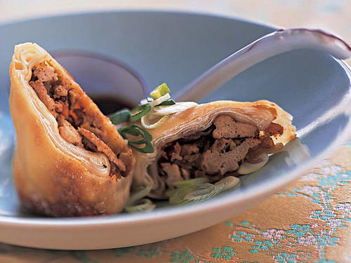 Everyone loves egg rolls; they're the quintessential Chinese side dish. Although traditional egg rolls are filled with meat or seafood and deep-fried, this recipe earns extra kudos for reducing the fat by substituting ground turkey and baking–not frying–the wraps. Jam-packed with cabbage, celery, and carrots, these rolls are a great, fun way to eat vegetables without even noticing. Whether you're making these cute finger foods for an entertaining appetizer or a hearty meal for dinner, they possess that signature Asian-inspired flavor that makes egg rolls so great without all of the added fat and sodium.