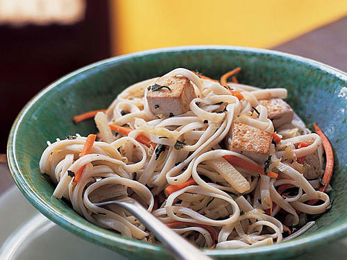 Udon noodles are a popular Japanese noodle made from wheat flour, traditionally served hot in the winter and chilled in the summer.  This dish features udon noodles sautéed with fresh vegetables and topped with teriyaki-infused tofu.