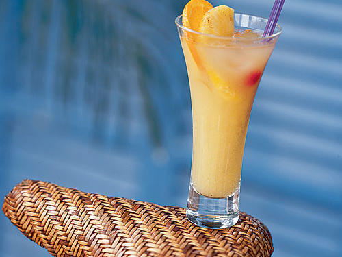 "A combination of sweet guava nectar, cool fruit juices, and rum create an island cocktail that's as beautiful as it is delicious. Annjones389 says, ""It tastes exactly like what you would expect to get on a tropical vacation. You can substitute passion fruit or another tropical juice if you can't find guava nectar, and it is just as good!"""