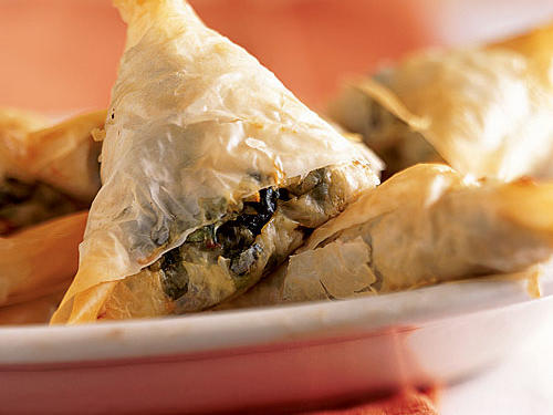 Wonderful as appetizers or a side, these miniature spinach pies enclose fresh spinach, feta cheese, and dried dill in folds of delightfully crispy phyllo dough. Reviewers reported that this recipe won over everyone from picky kids to spinach-phobic husbands and doubters of light fare.