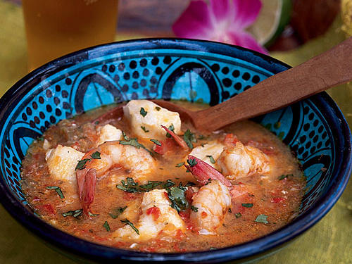 This traditional Brazilian seafood dish recipe comes from the state of Bahia in northern Brazil. The dish, moqueca de peixe, (moo-KAY-ka duh PAY-shuh) is a tropical fish stew fragrant with garlic and peppers, and enriched with coconut milk.