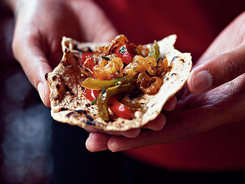A whole-wheat flour makeover gives this international recipe a healthful spin. Typical north Indian flatbread, chapati is traditionally made with just two ingredients flour and water. Its plain flavor complements spicy Indian dishes.