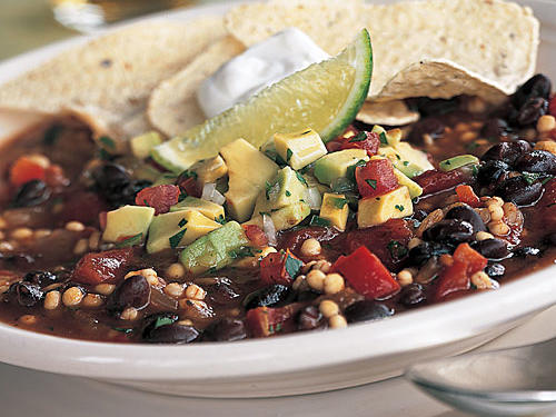 "This chili's avocado salsa really knocks its ratings from good to great. Reviewer wnlgt2 agrees, and offers a tip for the extra chili. ""This is one of the best and easiest chili recipes! I make it frequently in the winter and freeze some for later … don't leave off the avocado salsa—it makes it even better!"" You won't miss the meat in this hearty vegetarian chili. It's chock-full of fiber-rich black beans and barley, tomatoes, and green chiles. Top with a bright and refreshing avocado salsa, and scoop up every last drop with crisp tortilla chips. You'll find yourself returning to this easy vegetarian chili again and again. There's a lot to love."