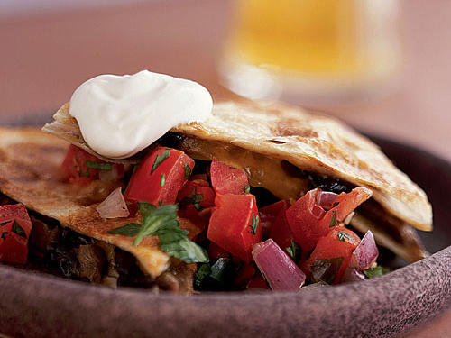 Meaty portobellos are paired with flavorful pancetta in this appetizer. Keep the cooked quesadillas warm in an oven set to low heat while you're preparing the rest.