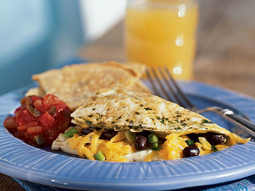 Black beans and cheddar make for a southwestern-inspired hearty omelet filling, but feel free to vary this recipe by using kidney beans or Monterey Jack cheese instead. Made to feed two, this omelet is perfect to share with your special someone or split amongst the kids for Sunday brunch.