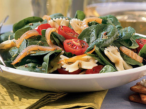 Bagged baby spinach helps this main-dish salad come together in a flash. Substitute leftover cooked salmon for the sliced smoked salmon, if you prefer.