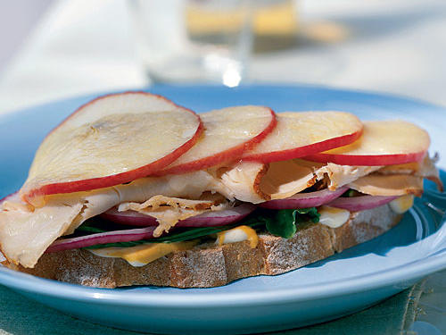 The flavors of fall meet in this sandwich. Tangy Havarti cheese provides a pleasing contrast to the sweet Pink Lady apples and spicy arugula. Substitute nutty fontina or mild Muenster for the Havarti, if you prefer.