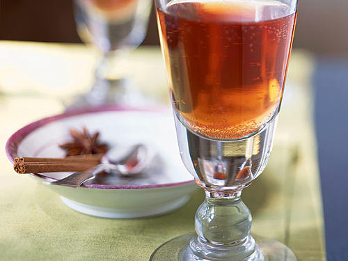 This cocktail kicks up staid mulled wine to a whole new level. Cranberry-pineapple juice is steeped with spices and combined with complex dark rum and spicy, sparkling ginger beer for a fizzy, peppery, and altogether refreshing experience.