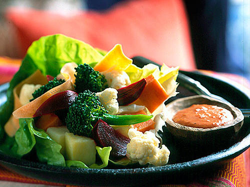 Traditional West African meals are not served in courses. Some families borrow a French custom and start meals with a plate of crudités--crisp vegetables that add color to the meal. The dipping sauce, similar to Thousand Island dressing, combines light mayonnaise and cocktail sauce.