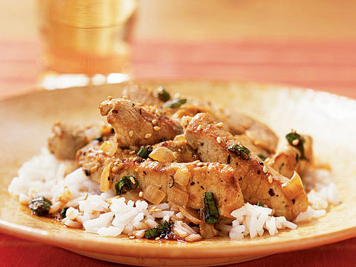It's only a half-hour of marinating that takes any time in this easy, easy recipe. After that, the pork is stir-fried for six minutes, and you're done. The bourbon-tinged pork matches perfectly with the sweet soy-and-ginger-flavored sauce. Serve with rice for a simple weeknight meal.