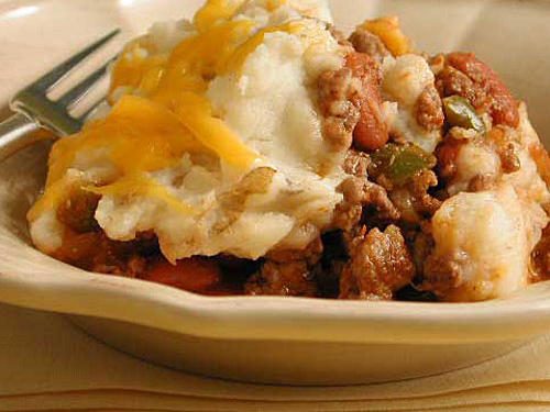 Seriously, what could be better on a rainy night than a pile of saucy beef and beans covered with creamy mashed potatoes and cheese? Our simple recipe tweaks the traditional version a bit by adding subtle Mexican flavors. To make the dish even more tasty, assemble in an oven-safe dish and broil until the cheese and potatoes just start to brown.