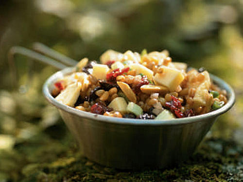 Bold flavors of both sweet and savory varieties make a statement in this salad chock-full of dried fruit. Make sure to soak the wheat berries two days ahead if you plan to prepare a day ahead.