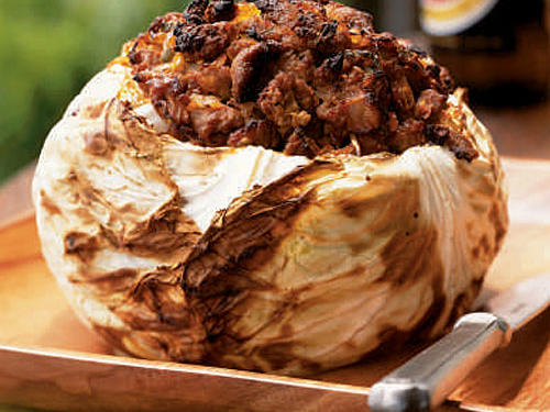 This richly flavored whole head of cabbage cooks slowly over moderate heat while covered. This preparation is a showpiece.