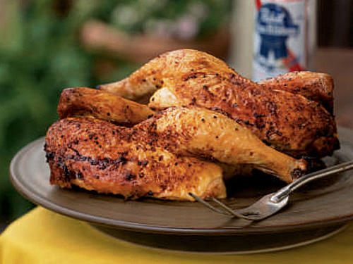 """I like any recipe that starts with 'open a can of beer and drink half,'"" says recipe developer and chef Steven Raichlen. American ingenuity has produced a variety of beer-can roasters that hold the can in place and stabilize the tipsy chicken. Aluminum cans bend easily under the pressure, so when piercing holes, it's a good idea to use a can-holding gadget."