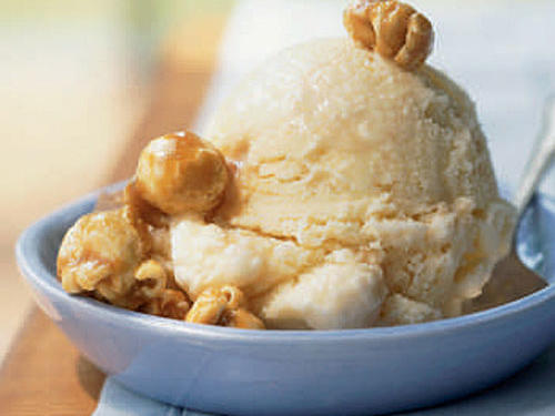 The just-frozen ice cream is still soft enough to stir in the melted caramels. For fun, sprinkle with caramel popcorn.