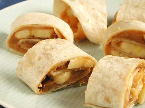 Give the classic peanut butter sandwich a twist by rolling up in a tortilla instead of serving on bread. These bite-sized spirals are good for little hearts because they provide heart-healthy monounsaturated fat from the peanut butter, potassium from the banana, and fiber from the wheat germ. 