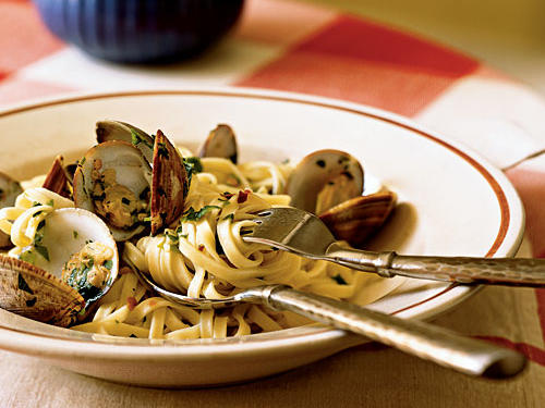 In Italy, the pasta partner of clams is almost always linguine. That's probably because the long noodles with a little al dente bite make such a great counterpoint to the plump, chewy clams. The basic and ridiculously easy cooking liquid/sauce will also work with any kind of shellfish, from shrimp to scallops to mussels.