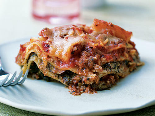 This slow-cooker lasagna is filled with super-satisfying flavors and textures that result in the ultimate comfort food. Three cheeses (mozzarella, provolone, and ricotta) meld with fresh spinach and sliced cremini mushrooms. Jarred pasta sauce and commercial pesto speed the prep time, and then the slow cooker does the work.