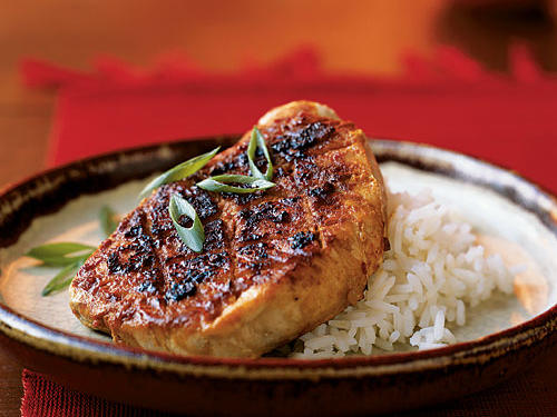 The simple brown sugar-and-spice rub gives these pork chops a nice crust and excellent flavor. The technique of lightly scoring their surface before applying the rub ensures it is well distributed throughout the meat―try it with any kind of steaks or chops. A skillet gives great results here, but this recipe can be just as easily prepared on the grill for an extra smoky element.