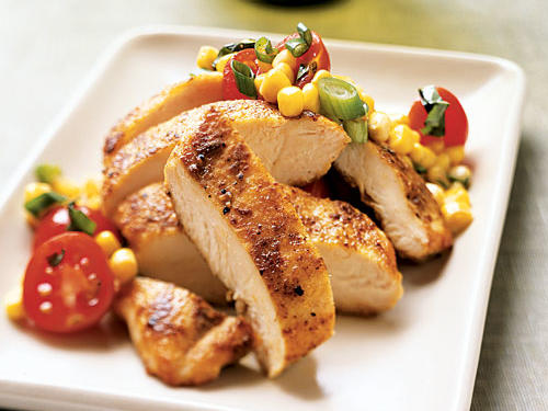 Tomatoes, basil, and olive oil are the holy trinity of summer flavor. Add to them a generous helping of sweet corn and sautéed chicken with a unique warm-but-mellow spice rub and you've got a near-perfect simple meal. With a fresh fruit salad on the side, this is an excellent light dinner to eat alfresco.