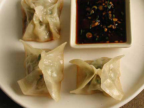 Take a break from creamy and cheesy with the light Asian flavor of these dumplings. A ginger-and-sesame-scented filling of chicken and crunchy veggies is balanced by the tart and salty dipping sauce, which awakens the palate with just a hint of heat.