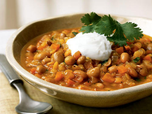 This meatless meal offers plenty of protein thanks to lentils and soybeans (look for canned soybeans next to the garbanzo beans in the supermarket). Don't forget to add a dollop of yogurt for a cool contrast to the heat.