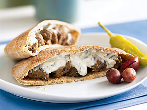 The gyro sandwich is a lunchtime favorite, but many restaurant versions are greasy and unhealthful. We use similar spices here, but replace ground lamb with sautéed pieces to save time, effort, and fat. With the easy cucumber-yogurt sauce, you've got a tasty Greek pita in about five minutes and with less than 400 calories.
