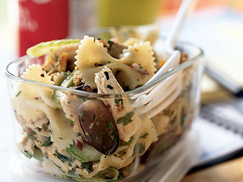 After you taste this dish, you'll be a convert: Mayonnaise has no place in pasta salad. The flavor―from a tart mustard citrus dressing―and contrasting textures―crunchy celery, onion, and walnut, chewy pasta, tender chicken, and juicy grapes―make an easy salad that can be made ahead and travels well, either for a dinner on the go or a workday lunch. Leftover chicken, or deli ham, or turkey can take the place of the store-bought rotisserie bird.