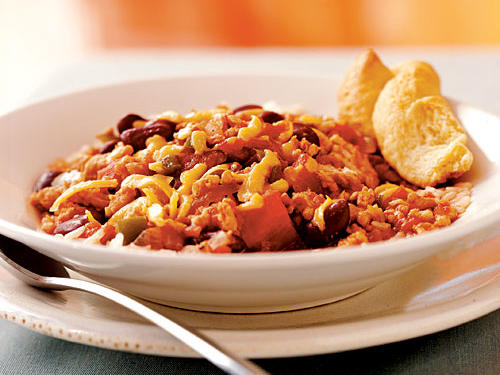 This dish has all the characteristics of a recipe you'll make often: It's warm and satisfying, it's quick and easy, and you can serve it in lots of different ways. Pouring the chili over rice makes for a filling and healthy meal, but you can also try it over cooked spaghetti (aka Cincinnati-style), stuffed in a baked potato, spooned over tortilla chips and topped with cheese to make nachos, or even with scrambled eggs for breakfast.