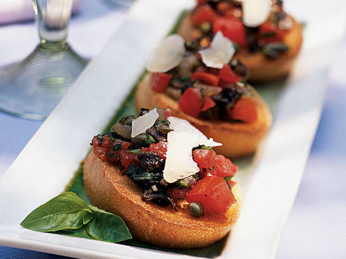 Bruschetta with chopped tomato and basil is certainly delicious. This recipe adds an element of surprise to the familiar with a combination of sautéed mushrooms, creating a brand new dish with deep savory flavor. Use whatever mushrooms are your favorite; if chanterelles or morels are in season, either is amazingly good here. Because it's used in such small quantity, high quality cheese is also important―spring for real Parmigiano-Reggiano.