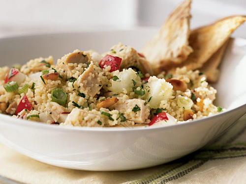 A great way to use leftover chicken and save time in the kitchen, this 20-minute dinner salad uses quick-to-cook couscous and lots of brightly flavored herbs for a great taste.