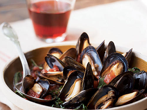 This recipe's made for two, and it's easy to turn it into a romantic meal: Eat with your fingers, sharing the mussels directly out of the cooking skillet, with a loaf of crusty bread nearby to sop up the sweet-and-briny broth. Of course, you can easily double or triple the recipe and serve in bowls to feed a hungry crowd (don't forget the bread!) as well.