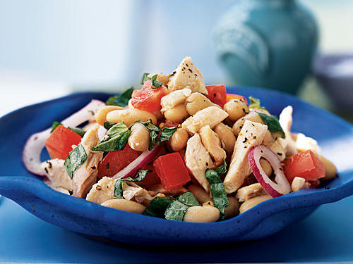 Creamy beans, sweet tomatoes, earthy basil, and homemade vinaigrette elevate chicken salad to new heights. Cannellini beans, or white kidney beans, are smaller than Great Northern beans and add just the right texture. Great for picnics or lazy-day suppers, this salad stirs together in a flash.