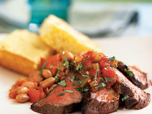 This is a cowboy meal―spiced grilled steak piled atop zesty beans―and guaranteed to fill you up. But we managed to keep it under 300 calories per serving. Pair with corn bread, fill flour tortillas for tacos, or try it atop greens as a salad.