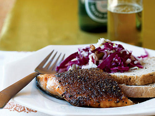 "The classic seasonings associated with beef pastrami taste fantastic on this grilled salmon. Allspice is a fairly strong spice, so if you're sensitive to its ""burn,"" use the lesser amount. Purchase a whole center-cut salmon fillet so that it will cook more evenly than a cut that contains the thinner tail end."