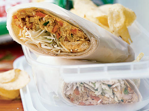 Bring the exotic to lunch with these easy make-ahead wraps. Chicken and vegetables are cooked in coconut milk, peanut butter, and curry for the traditional flavors of saté with peanut dipping sauce. Packaged slaw mix adds nutrition and crunch. Pair a wrap with exotic chips like sweet potato, taro, or purple potato.