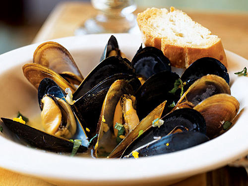Cardamom, orange, and mint sounds like a combination you'd find in a dessert, but they add a warmth and a citrusy sweetness to mussels that can't be beat. This recipe serves eight as an appetizer, but just double the serving size to make it a main course.