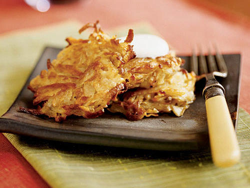 Use the shredder blade of a food processor to quickly shred the artichokes, potato, and carrot. Cook the latkes soon after combining the ingredients so the mixture does not become watery; if this happens, though, remove the mixture from the liquid using a slotted spoon.